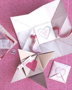 """As early as the 1790s, sweethearts exchanged """"puzzle purses."""" In this version, a poem runs along the edges, starting outside the folded square. The text, embellished with stamped and painted designs, is revealed in stages as the card is opened."""