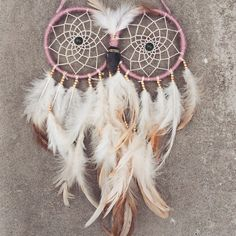 A personal favorite from my Etsy shop https://www.etsy.com/listing/229323153/owl-dream-catcher-double-pink-earthy-owl