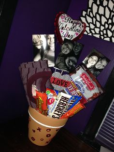 Valentine's Day gift for him! A flower pot filled with favorite candy and treats, a new shirt, and some favorite photos!