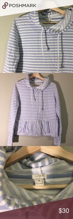 Powder blue and white striped hoodie Perfect for spring. This j. Crew hoodie has an alternating stripe pattern in powder blue and white, and a front tube pocket. In great condition except for two flaws: a stain on the hoodie draw string and one white spot (see photos for details). Oversized cut and stretchy fabric. Measures roughly 20 inches from armpit to armpit when flat and not stretched. Roughly 23 inches long. 100% cotton. Please message me if you have any questions. J. Crew Tops…