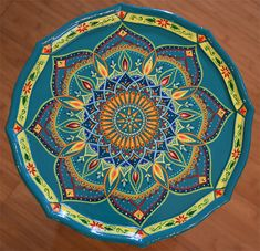 Just finished another small table. Its available for sale. Base color is turquoise. Hand painted wood round accent pedestal table, size 27 x 13.5 inches. On 3 legs. Boho style. Mandala design. Bohemian furniture. One of a kind! Only one available. Local pickup is also available. Item itself weights approx. 7 lb. The packaged item weights about 9 lb. Some assembly requred  All artwork created by Janna Matkovski.  * Please note colors may vary from monitor to monitor.