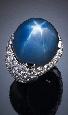 A ring set with an asteria sapphire weighing 72,40 carats and brilliant - cut diamonds 1950s