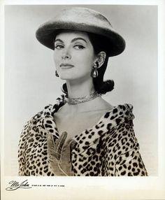 Carmen Dell Orefice wearing hat by Mr. John, 1956, leopard coat Women's vintage fashion photography photo image