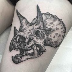 Dinosaur skull tattoo of triceratops