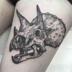 Dinosaur skull tattoo of triceratops