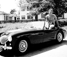 1956: Clint Eastwood, age 26, sits astride his British-made Austin-Healey convertible in Los Angeles ..