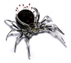 spider pin cushion  I have mixed feeling about this .... one one hand that cool on the other it still creeps me out too much to even look at it lol