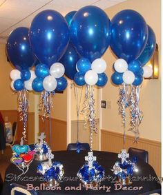 Ballon centerpiece with 4 quads with curly ribbon ona base of your choice that goes with your scheme