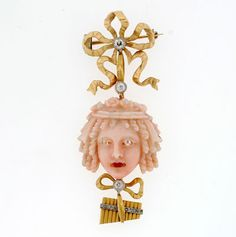 "Victorian Angel Skin Carved Coral Pin with Diamonds & Ruby, $3,640.00 / 2 1/4"" at the longest point"