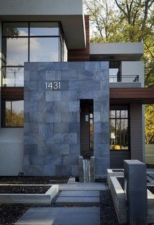 Dark natural slate tile. Also like the house numbers. This is my favorite look, but is slate durable outdoors?