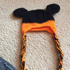 Crochet Mickey House Hat Handmade crocheted Mickey Mouse hat with ear flaps and braids is adorable to fit up to a 2 yr old. Yarn is orange and black.  Machine was, no trades Mara hoskin design Accessories Hair Accessories