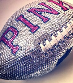 PINK Rhinestone football <3 I know this is overly girlie but I like it! lol