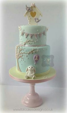 Fondant Cake in Pastel Colors with Bunny, Tree, and Birdhouse with Birds.