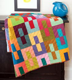 Inspired by a quilt designed by Janine Burke ofBlue Underground Studio, Kristine Peterson used bright-color solid cottonsfor her striking quilt creation. This quilt, Color Study, is fat-quarter friendly.