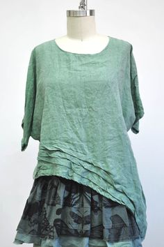 Features:   	Basic pullover shirt  	Short sleeve  	Detail at hem  	Asymmetrical Hem  	Over sized  	100% Linen, Jade  	Fits Sizes 2-20  Pictured with: Underpinning Cami & Short My Favorite Skirt