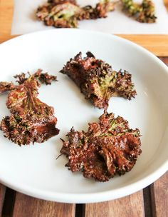 Chocolate Coconut Kale Chips.  Vegan, GF, easy.  Can bake in oven or dehydrate. Kale never tasted so good until it's coated in chocolate!