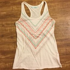 Patterned tank Only worn a few times, super cute racer back tank Tops Tank Tops