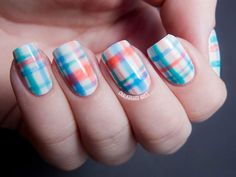 A cool combination of white and orange stripes over a white base coat. this plaid design looks simple and clean.