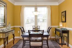 Fancy yellow dining area at the Nottingham II in Washington Trail by Dan Ryan Builders. Home Style Ideas