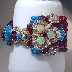 Set Bracelet Red spinels, Turquoise, Rubellites, White Opals, Diamonds# Van Cleef & Arpels# Biennale 2014# www.thejewelryicon.com