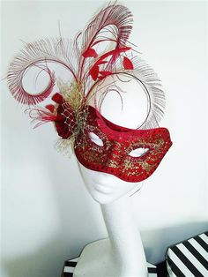 Couture silk covered masquerade ball mask with elastic fastening. Perfect for Masked balls, Halloween, Mardi gras and special events. Embelished with swarovski crystals, gold veiling, mini cabbage rose, hand curled peacock swords and stripped coq feathers.