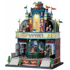 CHRISTMAS WONDERLAND TOY STORE, • ART. 05070 • ANNO DI RILASCIO: 2010 • VILLAGGIO: SANTA'S WONDERLAND • CATEGORIA: Attrazioni  • Dim.Approx LxHxP cm: 22,6x30,5x21,9  Edificio in Porcellana Illuminato, Acquirenti girano dentro e fuori dal negozio. I giocattoli girano al secondo piano del Toy Store Canzone in lingua Inglese Con Controllo del Volume ed interruttore ON / OFF Adattatore Incluso Questa unita' consuma circa 540mA a 4.5V DC