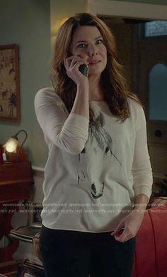 Lorelai's horse print sweater on Gilmore Girls: A Year in the Life.  Outfit Details: https://wornontv.net/63623/ #GilmoreGirls