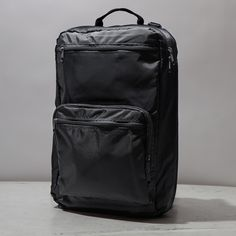 Black Global Nomad Convertible Backpack from Men In Cities