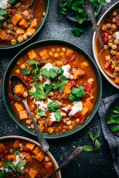 This Moroccan-spiced stew is packed with chickpeas, lentils, tomatoes and sweet potatoes. It's gluten free, vegan, and ready in about 45 minutes. Moroccan Stew, Moroccan Spices, Chickpea Stew, Lentil Stew, Veggie Recipes, Healthy Recipes, Veggie Meals, Soup Recipes, Vegetarian Recipes