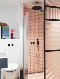 Modern colourful bathroom with frosted glass wall and pink/peach tiles and black faucet. Small Bathroom Shelves, Wooden Bathroom, Glass Bathroom, Bathroom Wall, Bathroom Ideas, Downstairs Bathroom, Bathroom Inspo, Bathroom Remodeling, Peach Bathroom
