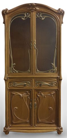 Eugène Gaillard (1862-1933) - Cabinet. Mahogany and Glass with Bronze Hardware. Circa 1900.