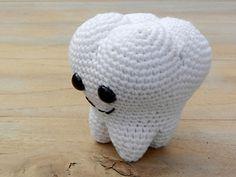 OMG, how funny and cute. A crochet molar!