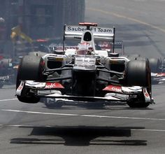 Japanese Formula One driver Kamui Kobayashi of Sauber goes airborne following a collision during the start of the 2012 Monaco Formula One Grand Prix at the Monte Carlo. http://www.etsy.com/dk-en/listing/175971979/the-chequered-flag-earphones-with-tangle?ref=listing-shop-header-0
