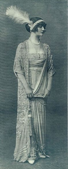 Lucile studio designs, circa 1911-20. comprising: long beaded pink evening gown with pointed train, blue aigrette, signed. The pink gown was was originally designed for Lily Elsie in 'The Count of Luxembourg' on the London stage in 1911. It is one of the earliest Lucile sketches ever to come onto the market.
