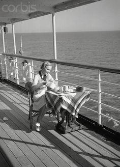 Female Passenger Having Tea Alone on Cruise Ship