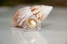 Ladies Champagne South Sea Pearl and Diamond Ring, 14mm champagne pearl accented with .32 carats of round diamonds set in 18kw gold. John Ford Jewelers #galveston
