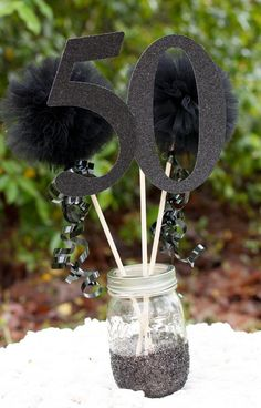 "Fun black & white ""over the hill"" 50th birthday party centerpiece idea."