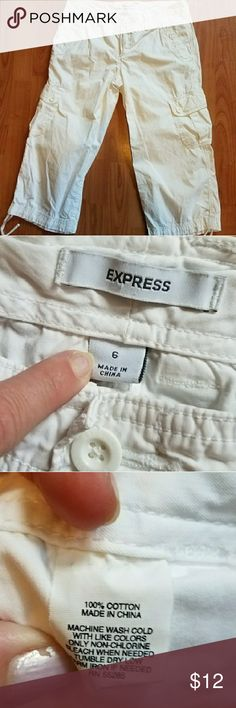 EXPRESS white cotton cargo capris These capris have been worn but are in excellent condition. The waist measures at 16 inches across, there is an 8 inch rise, and the inseam is 20 inches. Express Pants Capris
