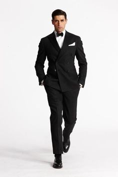 Look sharp in black and white + bow tie!  www.the-bridal-connection.com