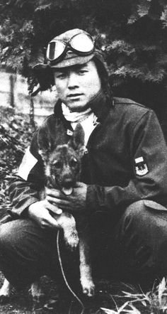 """ppsh-41: """" Japanese fighter pilot, Kiyoshi Ito with a puppy. During the fighting in the Pacific, Kiyoshi shot down 17 enemy aircraft. """""""