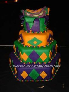 Homemade Mardi Gras Fund Raiser Cake: This Homemade Mardi Gras Fund Raiser Cake is a completely edible cake. The masks are made from a candy mold. The beads are Sixlet candies. A heated needle
