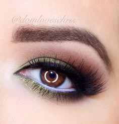 Olive green n brown shadow. Upper black and lower white eye liner. Nice.   Eye makeup