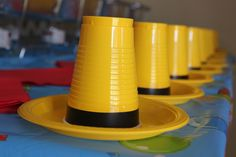 Yellow solo cups with black tape and yellow plates to make hat