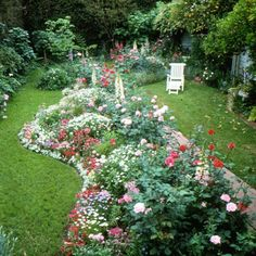 This trick may seem contradictory, but we promise it works: Break up open areas of a small space so it feels larger. Here, a colorful bed of roses, annuals, and perennials effectively divides a small back yard landscape into attractive nooks. Landscape Design, Garden Design, House Design, My Secret Garden, Lawn And Garden, Garden Bed, Garden Spaces, Garden Inspiration, Design Inspiration