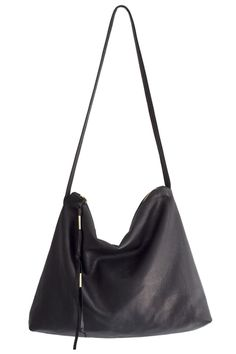 Throw on some skinnies and a black hat along with this bag and you're ready to hit the town!