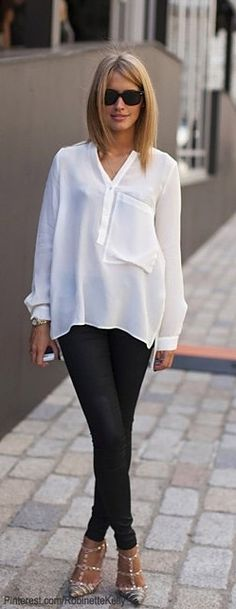 Check out the oversize patch pocket on this linen(?), silk (?) tunic! A great detail. And those Valentino studded shoes...love those!