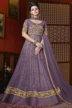 Lavender Heavy Net embroidered Traditional Occasionally Wedding Gown style Anarkali Suit #swagat #snowwhite #embroidery #purplesuits #zariembroidery #floorlengthanarkalis #fancyanarkalis #netfabric #shadiseason #festivaldresses #gown #anarkali #uk #banglore #france #london #kenya #partywear #weddingseason #weddingwear