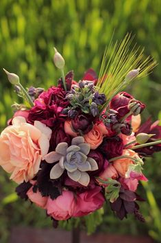 This was a little bouquet I threw together this past spring. I'm guessing you don't want the peach but what do you think about the dark wine/purple and the succulent in there?