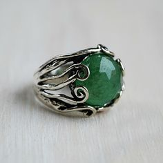 "Sterling silver envelops a beautiful round faceted green adventurine! A bejeweled representation of the northwest coast veiled in moss. Handcrafted, ring measures 5/8"" from top to bottom. Tapers in the back for a comfortable fit. Whole sizes 5-10 Materials: .925 sterling silver, green adventurine"