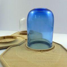 """Florent Degourc : """"Archipel"""",  îlots de bois surmontés de photophores en verre soufflé."""